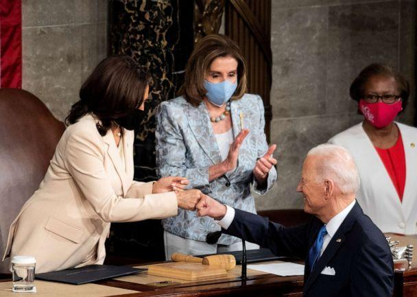 PHOTO: President Joe Biden fist bumps with Vice President Kamala Harris as Speaker of the House Nancy Pelosi claps at the end of his address to the joint session of Congress in the House chamber of the U.S. Capitol in Washington, April 28, 2021. (Caroline Brehman/Pool via Reuters)