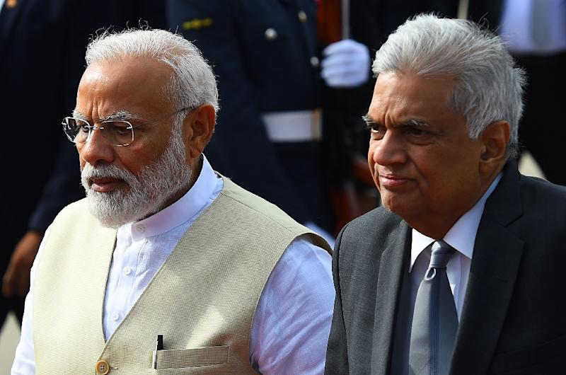 Sri Lankan Prime Minister Ranil Wickremesinghe (right) walks with Indian Prime Minister Narendra Modi (left) at Bandaranaike International Airport near Colombo (AFP Photo/ISHARA S. KODIKARA)
