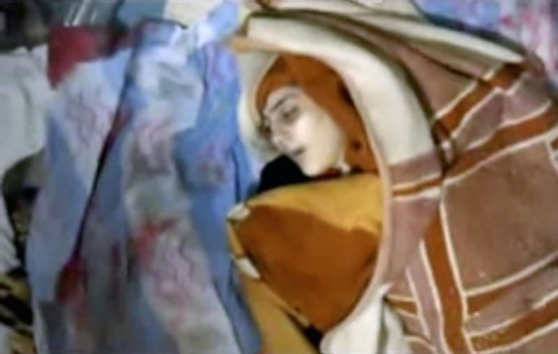 This image made from amateur video released by Shaam News Network and accessed Saturday, June 9, 2012, purports to show a blanket-wrapped body after shelling in Daraa, Syria. Syrian troops shelled the southern city of Daraa early on Saturday, killing more than a dozen people, activists said.(AP Photo/Shaam News Network via AP video)THE ASSOCIATED PRESS CANNOT INDEPENDENTLY VERIFY THE CONTENT, DATE, LOCATION OR AUTHENTICITY OF THIS MATERIAL