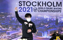 Yuma Kagiyama of Japan celebrates after the results of his performing during the Men Short Program at the Figure Skating World Championships in Stockholm, Sweden, Thursday, March 25, 2021. (AP Photo/Martin Meissner)