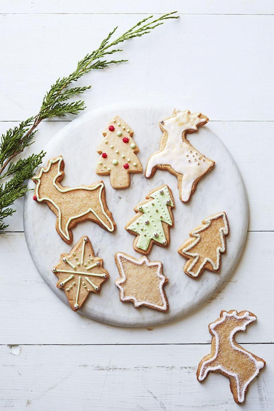 """<p>Baking cutout cookies on Christmas morning fills your home with a delectable aroma and gives the kids something fun to do. Don't worry if your cookies come out a little misshapen or the little ones go a little wild with the sprinkles; they'll still taste amazing.</p><p><em><a href=""""https://www.goodhousekeeping.com/food-recipes/a15769/traditional-cutouts-recipe-ghk1214/"""" rel=""""nofollow noopener"""" target=""""_blank"""" data-ylk=""""slk:Get the recipe for traditions cutout Christmas cookies »"""" class=""""link rapid-noclick-resp"""">Get the recipe for traditions cutout Christmas cookies »</a></em> </p>"""