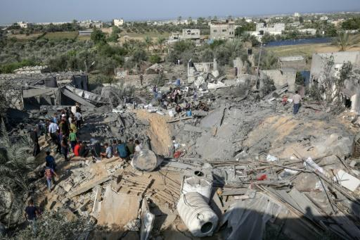 Palestinians salvage what they can from the wreckage of a building flattened by an Israeli air strike on the Gaza Strip city of Khan Yunis on Thursday