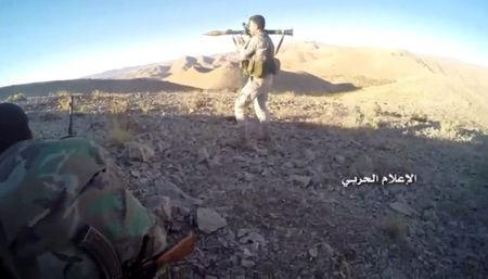 A still image taken on August 19, 2017 from a footage of Hezbollah military handout shows a Hezbollah fighter holding an RPG at western Qalamoun, Syria. Hezbollah Military Handout via Reuters TV.