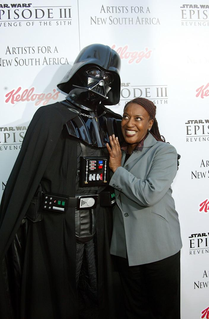 WESTWOOD , CA - MAY 12: Actress CCH Pounder arrives with Darth Vader to the 'Star Wars Episode III - Revenge Of The Sith' Los Angeles Premiere at the Mann Village Theatre on May 12, 2005 in Westwood, California. The premiere benefits the charity Artists for a New South Africa and its comprehensive, ground-breaking program for South African children orphaned by HIV/AIDS. (Photo by Frederick M. Brown/Getty Images)