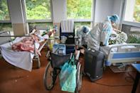 Figures released Friday in Romania showed the highest death toll of the entire pandemic reported in one day, with 385 people succumbing to the virus (AFP/Daniel MIHAILESCU)