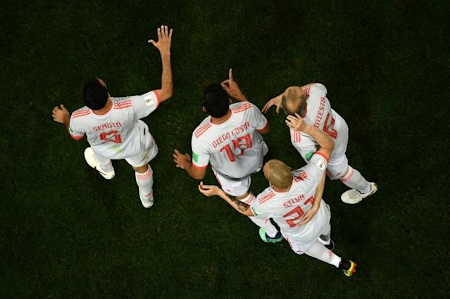 Spain forward Diego Costa (centre) is congratulated by teammates after scoring against Spain