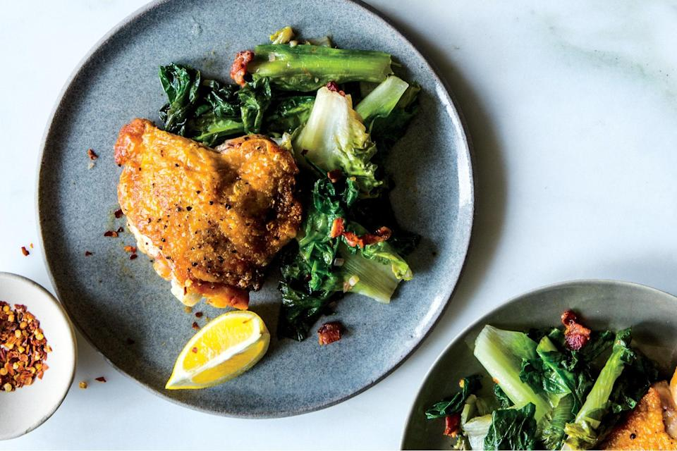 """Sauté bacon and escarole while seared chicken thighs rest for an easy side dish you'll put on repeat. <a href=""""https://www.epicurious.com/recipes/food/views/crispy-chicken-thighs-with-bacon-and-wilted-escarole?mbid=synd_yahoo_rss"""" rel=""""nofollow noopener"""" target=""""_blank"""" data-ylk=""""slk:See recipe."""" class=""""link rapid-noclick-resp"""">See recipe.</a>"""