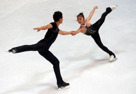 FILE PHOTO: Figure Skating - Olympic Qualifying ISU Challenger Series - Pairs Free Skating - Oberstdorf, Germany - September 29, 2017 - Ryom Tae-Ok and Kim Ju-Sik of North Korea compete. REUTERS/Michael Dalder /File Photo