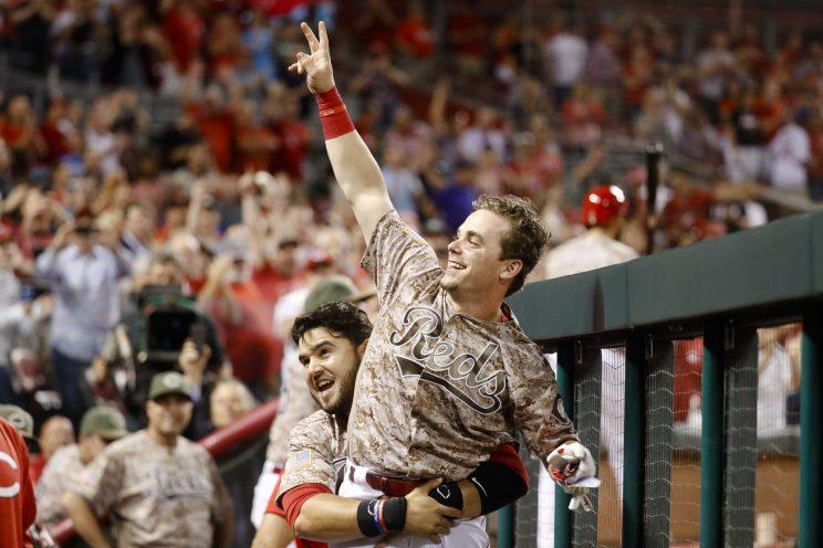 Scooter Gennett made MLB history by bashing four homers in one game. (AP)