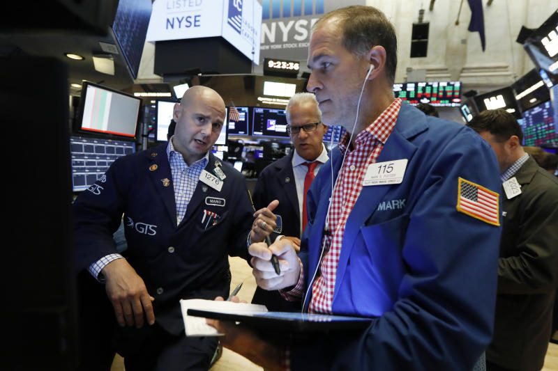 Specialist Mario Picone, left, works with traders at his post on the floor of the New York Stock Exchange, Friday, Aug. 16, 2019. Stocks are opening broadly higher at the end of a turbulent week. (AP Photo/Richard Drew)