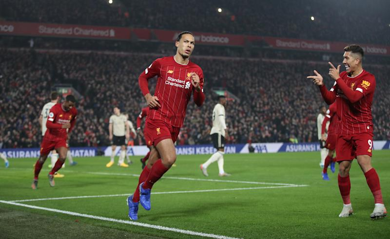 "Soccer Football - Premier League - Liverpool v Manchester United - Anfield, Liverpool, Britain - January 19, 2020 Liverpool's Virgil van Dijk celebrates scoring their first goal with Roberto Firmino Action Images via Reuters/Carl Recine EDITORIAL USE ONLY. No use with unauthorized audio, video, data, fixture lists, club/league logos or ""live"" services. Online in-match use limited to 75 images, no video emulation. No use in betting, games or single club/league/player publications. Please contact your account representative for further details."