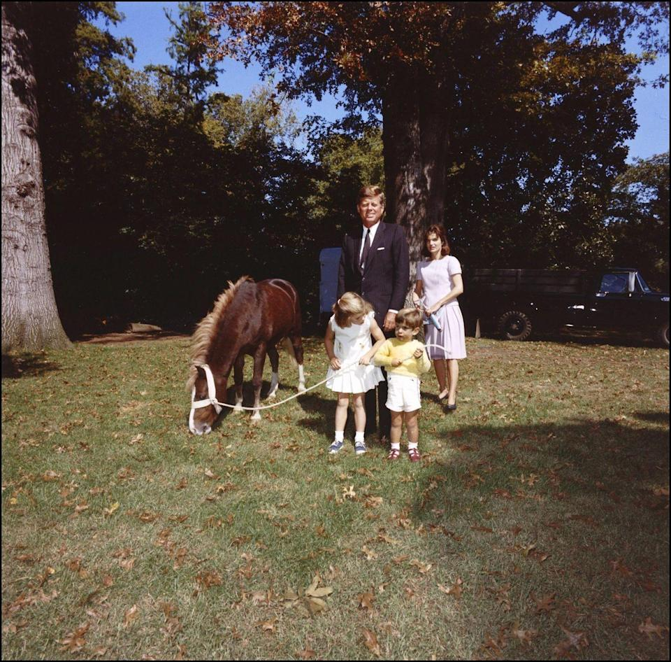 <p>The Kennedys posed with Caroline's pony, Macaroni.</p>