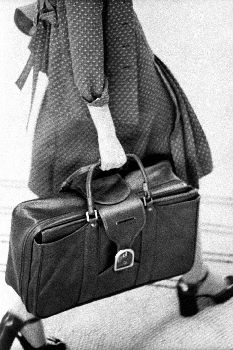 <p>Rectangular briefcases weren't just for work; it became the accessory women brought with them everywhere, and it was more practical than a tiny handbag for stashing all your stuff. </p>