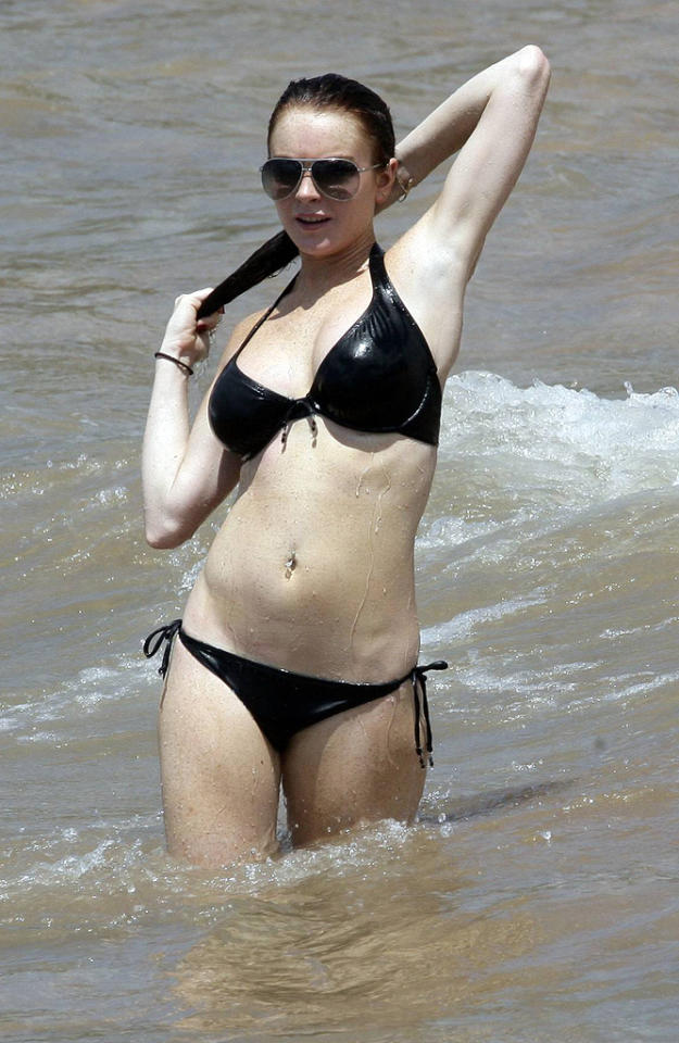 "<p class=""MsoNormal"">The ""Liz & Dick"" star went for a simple black bikini that fit her large chest perfectly during a romantic <a target=""_blank"" href=""http://www.x17online.com/"">getaway </a>to Hawaii in September 2006 with then-boyfriend Harry Morton. The understated suit let Lohan's curves do all the talking! (9/1/2006)</p>"