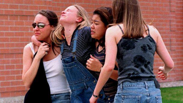 PHOTO: Young women head to a location near Columbine High School where students and faculty members were evacuated after two gunmen went on a shooting rampage in the school in the southwest Denver suburb of Littleton, Colo., April 20, 1999. (Kevin Higley/AP, FILE)