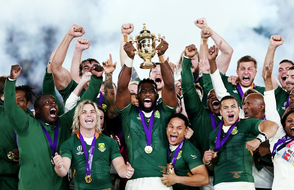 YOKOHAMA, JAPAN - NOVEMBER 02: Siya Kolisi of South Africa lifts the Web Ellis cup following his team's victory against England in the Rugby World Cup 2019 Final between England and South Africa at International Stadium Yokohama on November 02, 2019 in Yokohama, Kanagawa, Japan. (Photo by David Rogers/Getty Images)