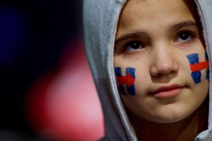 <p>Elle Kesler, 10, with face paint of the Hillary Clinton campaign logo on her cheeks, listens to the U.S. Democratic presidential candidate during her final rally at Independence Hall on the eve of election day in Philadelphia, Pa., on Nov. 7, 2016. (Mark Makela/Reuters) </p>