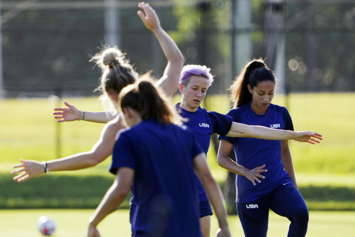 Megan Rapinoe, second right, and her teammates warm up at a training session of United States women's soccer team at Prince Takamado Memorial JFA YUME Field Saturday, July 17, 2021, in Chiba, near Tokyo. (AP Photo/Eugene Hoshiko)