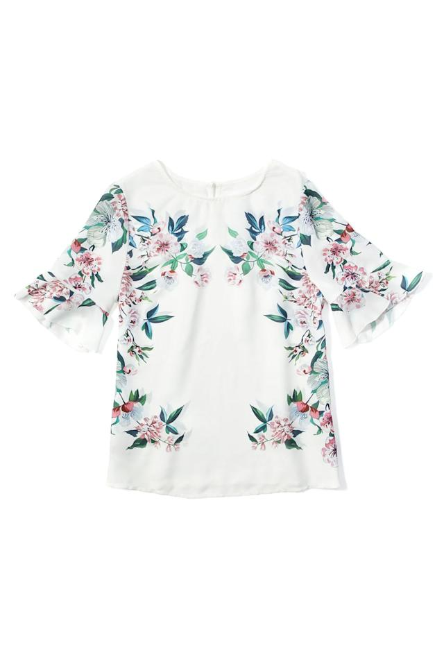 """<p><em>$11 </em></p><p><a rel=""""nofollow"""" href=""""http://us.shein.com/Trumpet-Sleeve-Keyhole-Back-Botanical-Blouse-p-375380-cat-1733.html"""">SHOP NOW</a><br></p><p>Update her spring go-tos with this floral printed blouse that you can dress up with a skirt or dress down with jeans and sneaks.</p>"""