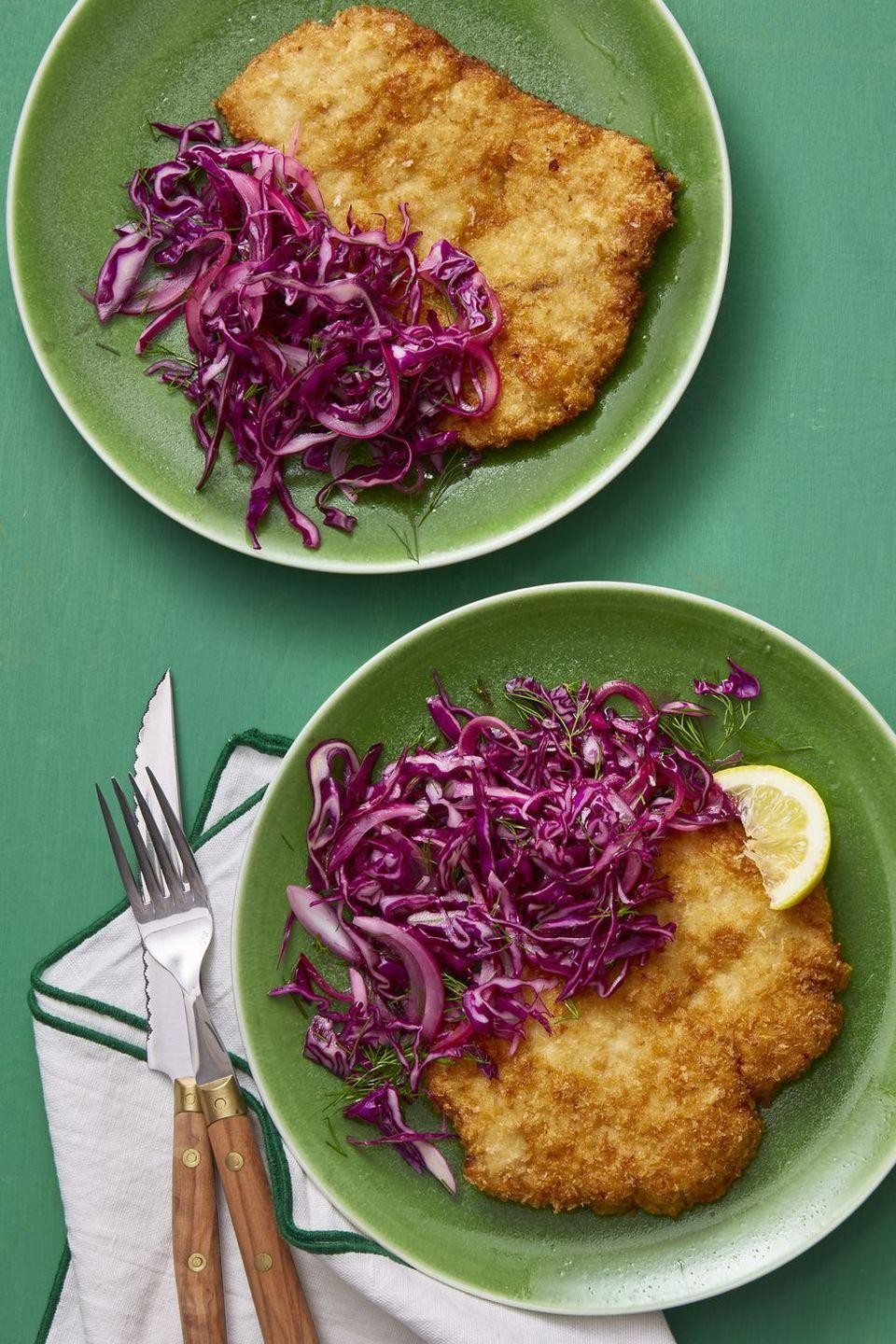 """<p>Enjoy with cabbage Caraway salad next to a crisp pork schnitzel, or on its own. </p><p><em><a href=""""https://www.womansday.com/food-recipes/food-drinks/recipes/a60710/pork-schnitzel-with-red-cabbage-and-caraway-salad-recipe/"""" rel=""""nofollow noopener"""" target=""""_blank"""" data-ylk=""""slk:Get the recipe from Woman's Day"""" class=""""link rapid-noclick-resp"""">Get the recipe from Woman's Day</a></em><em><a href=""""https://www.delish.com/cooking/recipe-ideas/a20958094/low-carb-cabbage-enchilada-recipe/"""" rel=""""nofollow noopener"""" target=""""_blank"""" data-ylk=""""slk:»"""" class=""""link rapid-noclick-resp""""> »</a></em></p>"""