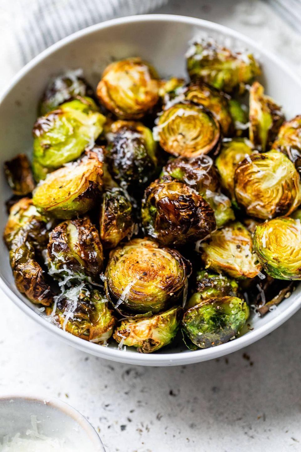 """<p>Is there anything an air fryer can't do!? These simple sprouts crisp up beautifully in just 12 minutes.</p><p><strong>Get the recipe from <a href=""""https://www.wellplated.com/air-fryer-brussels-sprouts/"""" rel=""""nofollow noopener"""" target=""""_blank"""" data-ylk=""""slk:Well Plated by Erin"""" class=""""link rapid-noclick-resp"""">Well Plated by Erin</a>.</strong></p><p><strong><a class=""""link rapid-noclick-resp"""" href=""""https://go.redirectingat.com?id=74968X1596630&url=https%3A%2F%2Fwww.walmart.com%2Fip%2FNinja-5-5-Quart-Air-Fryer-Max-XL-AF161-in-Black-and-Silver%2F526756471&sref=https%3A%2F%2Fwww.thepioneerwoman.com%2Ffood-cooking%2Fmeals-menus%2Fg37328783%2Fbrussels-sprouts-recipes%2F"""" rel=""""nofollow noopener"""" target=""""_blank"""" data-ylk=""""slk:SHOP AIR FRYERS"""">SHOP AIR FRYERS</a><br></strong></p>"""