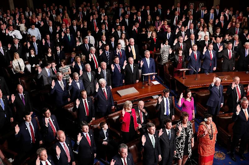 US lawmakers, seen taking the oath of fofice in January 2017, are up against a hard deadline of funding federal operations by April 28, 2017 at midnight, or face a government shutdown (AFP Photo/WIN MCNAMEE)