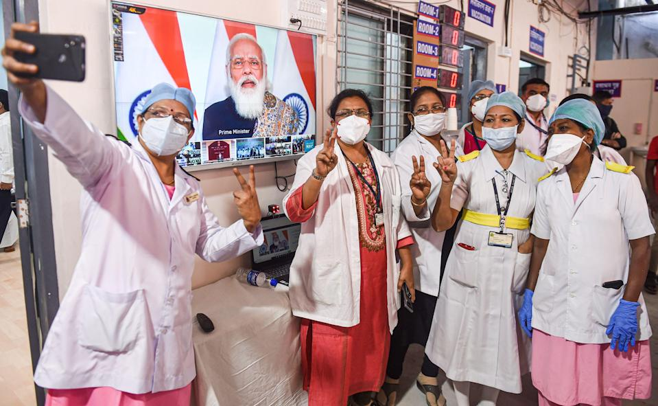 Mumbai: Doctors and health workers take a selfie, after the virtual launch of COVID-19 vaccination drive by Prime Minister Narendra Modi, at Rajawadi hospital in Mumbai, on Saturday, 16 January 2021.