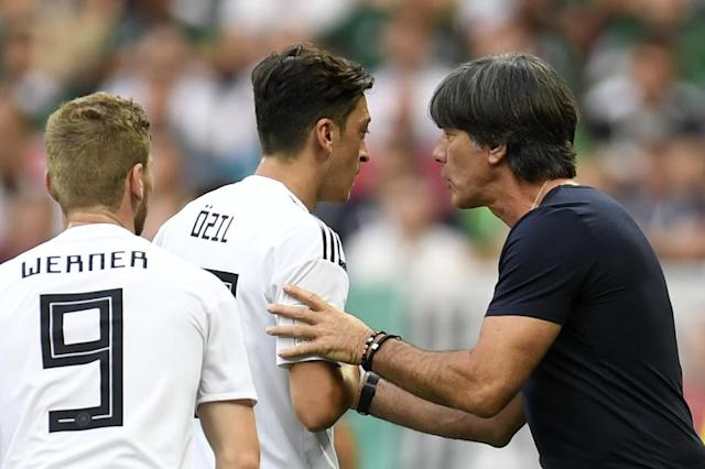 Germany coach Joachim Loew (right) must lift his team after they lost their first match at the World Cup (AFP Photo/Patrik STOLLARZ)