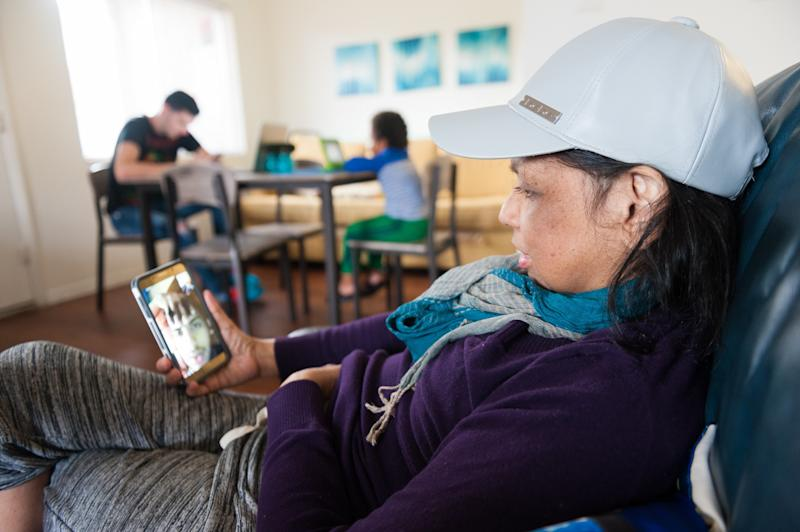 Mariluz talks on video chat with her son Jeancarlo. (Chris McGonigal/HuffPost)