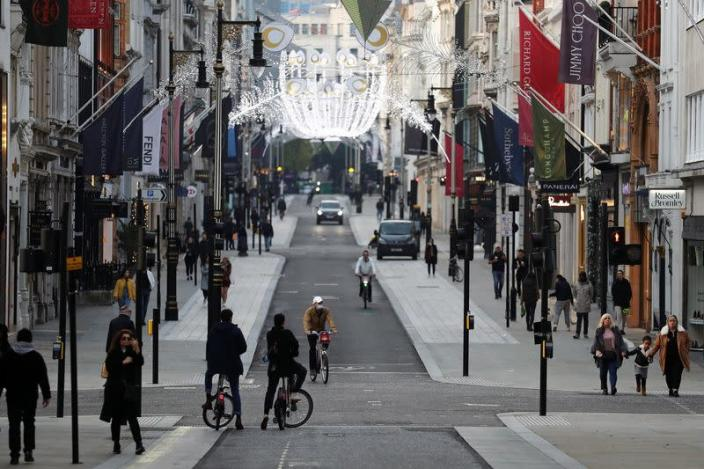 Pedestrians and cyclists move through New Bond Street amid the coronavirus disease (COVID-19) outbreak in London