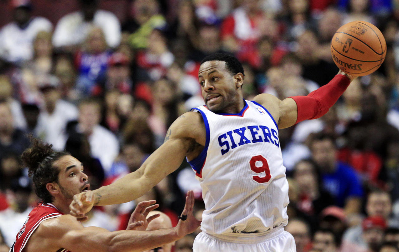 Philadelphia 76ers' Andre Iguodala (9) holds the ball away from Chicago Bulls' Joakim Noah (13) during the first quarter of Game 3 in an NBA basketball first-round playoff series in Philadelphia, Friday, May 4, 2012. (AP Photo/Mel Evans)