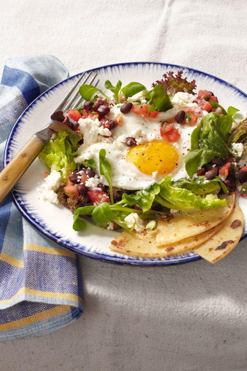 """<p>Say olé to the new year while digging into this delicious medley of <a href=""""https://www.goodhousekeeping.com/food-recipes/g3674/best-mexican-recipes/"""" rel=""""nofollow noopener"""" target=""""_blank"""" data-ylk=""""slk:Mexican"""" class=""""link rapid-noclick-resp"""">Mexican</a> flavors. </p><p><em><a href=""""https://www.goodhousekeeping.com/food-recipes/a14633/huevos-rancheros-salad-recipe-clv0214/"""" rel=""""nofollow noopener"""" target=""""_blank"""" data-ylk=""""slk:Get the recipe for Huevos Rancheros Salad »"""" class=""""link rapid-noclick-resp"""">Get the recipe for Huevos Rancheros Salad »</a></em></p>"""