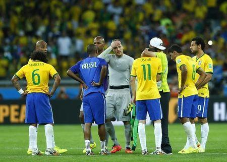 Brazil players react after the 2014 World Cup semi-finals between Brazil and Germany at the Mineirao stadium in Belo Horizonte July 8, 2014. REUTERS/Eddie Keogh