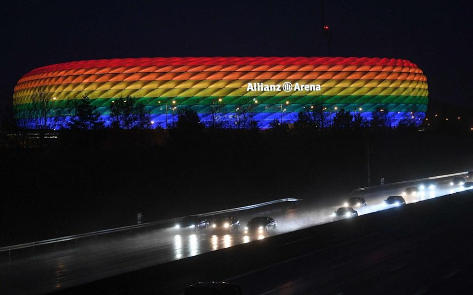 In this file photo taken on January 30, 2021 traffic passes the Allianz Arena illuminated in the rainbow colours after the German first division Bundesliga football match FC Bayern Munich v TSG 1899 Hoffenheim in Munich, southern Germany - ANDREAS GEBERT/POOL/AFP via Getty Images