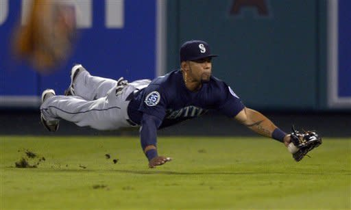 Seattle Mariners right fielder Eric Thames makes a diving catch on a ball hit by Los Angeles Angels' Maicer Izturis during the second inning of their baseball game, Tuesday, Sept. 25, 2012, in Anaheim, Calif. (AP Photo/Mark J. Terrill)