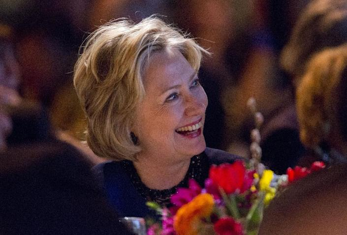 Former Secretary of State Hillary Rodham Clinton listens before receiving the American Jewish Congress' lifetime achievement award on Wednesday March 19, 2014, in New York. (AP Photo/Jin Lee)