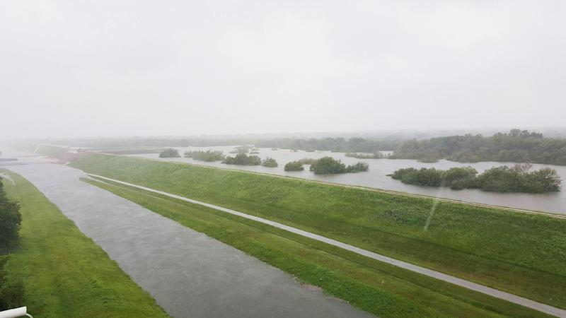 (Police block a flooded road near the Barker and Addicks reservoirs in Houston)