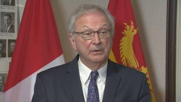 New Brunswick Premier Blaine Higgs defends his government's COVID-19 vaccine rollout plan speaking to reporters at the legislature on Tuesday, March 23, 2021.