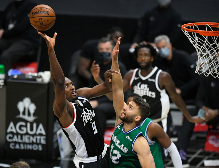 Clippers' Serge Ibaka shoots over Dallas' Maxi Kleber on Dec. 27 at Staples Center.