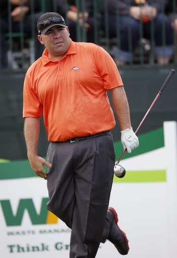 Kevin Stadler watches his tee shot on the first hole during the third round of the Phoenix Open golf tournament Saturday, Feb. 1, 2014, in Scottsdale, Ariz. (AP Photo/Ross D. Franklin)