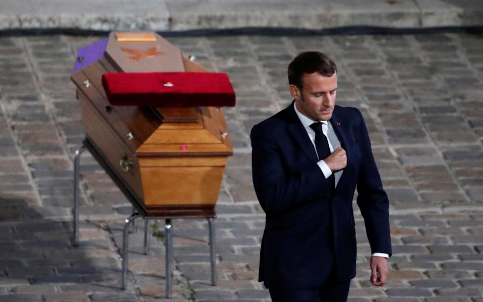 French President Emmanuel Macron paid his respects  - Francois Mori/Pool via REUTERS