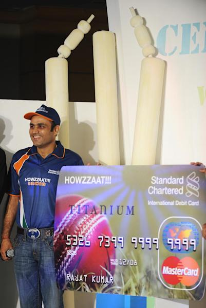 A file photo shows Indian cricketer Virender Sehwag at a promotional event for Standard Chartered bank in Mumbai in 2009 (AFP Photo/Sajjad Hussain)