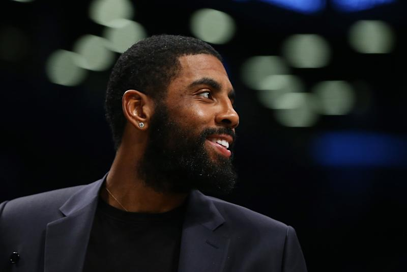 Nets point guard Kyrie Irving returned to practice for the first time since mid-November. (Mike Stobe/Getty Images)