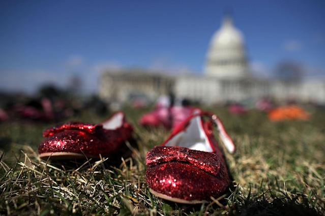 <p>7,000 pairs of shoes, representing the children killed by gun violence since the mass shooting at Sandy Hook Elementary School in 2012, are spread out on the lawn on the east side of the U.S. Capitol March 13, 2018 in Washington. (Photo: Chip Somodevilla/Getty Images) </p>