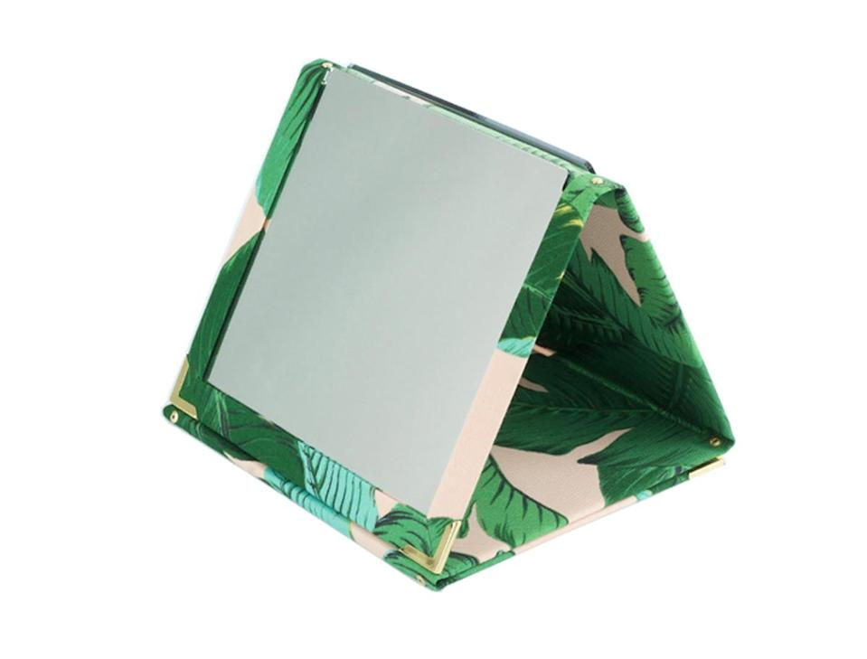 """<p>We're obsessed with the ingenuity like Magic Mirror. The original fold-up mirror is the most practical item you'll take with you to your fest… why? It can be folded in any which way you like or hung in your tent for those more bouji camping set-ups. <br><a rel=""""nofollow noopener"""" href=""""https://magicmirroruk.com/product/pink-bahama-island/"""" target=""""_blank"""" data-ylk=""""slk:Buy here."""" class=""""link rapid-noclick-resp"""">Buy here.</a> </p>"""