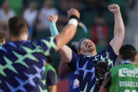Ryan Crouser celebrates after setting a world record during the finals of men's shot put at the U.S. Olympic Track and Field Trials Friday, June 18, 2021, in Eugene, Ore. (AP Photo/Charlie Riedel)
