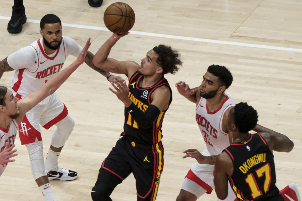 Atlanta Hawks guard Trae Young (11) shoots against the Houston Rockets during the first half of an NBA basketball game on Sunday, May 16, 2021, in Atlanta. (AP Photo/Ben Gray)
