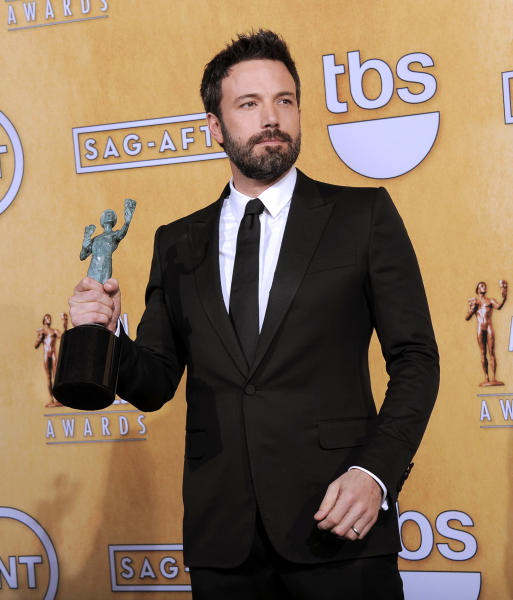"Actor Ben Affleck poses backstage with the award for best cast in a motion picture for ""Argo"" at the 19th Annual Screen Actors Guild Awards at the Shrine Auditorium in Los Angeles on Sunday Jan. 27, 2013. (Photo by Chris Pizzello/Invision/AP)"