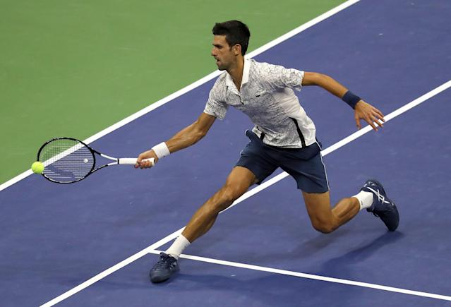 "<a class=""link rapid-noclick-resp"" href=""/olympics/rio-2016/a/1156004/"" data-ylk=""slk:Novak Djokovic"">Novak Djokovic</a> of Serbia hits a reutrn to <a class=""link rapid-noclick-resp"" href=""/olympics/rio-2016/a/1103180/"" data-ylk=""slk:Kei Nishikori"">Kei Nishikori</a> of Japan during their semi-final match on the twelfth day of the US Open Tennis Championships. EFE/EPA/BRIAN HIRSCHFELD *** Local Caption *** 53000073"