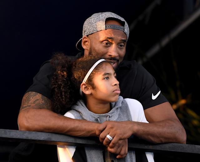 Kobe Bryant and daughter Gianna Bryant watch during day 2 of the Phillips 66 National Swimming Championships at the Woollett Aquatics Center on July 26, 2018 in Irvine, California. (Photo by Harry How/Getty Images)